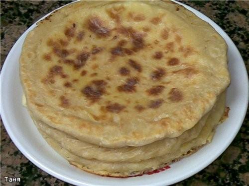 Пирог-хлеб с тунцом Пирожки треугольники с тыквой и шпинатом Гнездышки из слоенного теста с мясом и... - 8