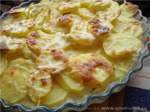 Картофель Дофинэ картофель соль молотый перец 1 яйцо 0,5 стакана молока твердый сыр 1 зубчик чеснок...