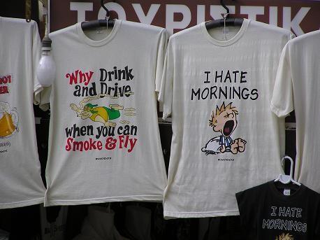 Приколы на футболках: (надпись слева: зачем пить и водить, когда можно курить и летать , надпись сп...