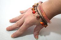 браслет красно-оранжевый двухрядный с подвесками на цепочке (№ 2)